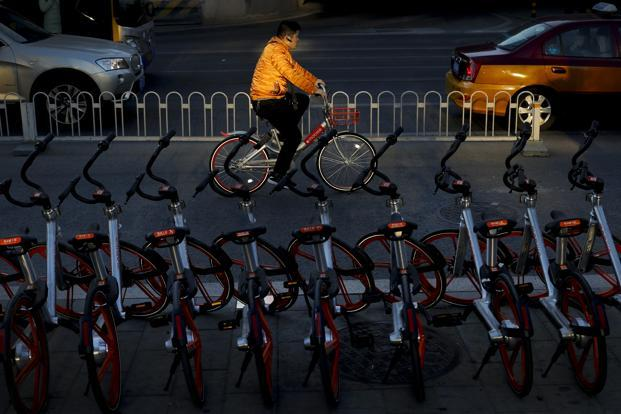 Mobike is among the largest of a growing crop of private bike-sharing operators, known for its distinctive orange-hued and GPS-equipped bikes. Photo: AP