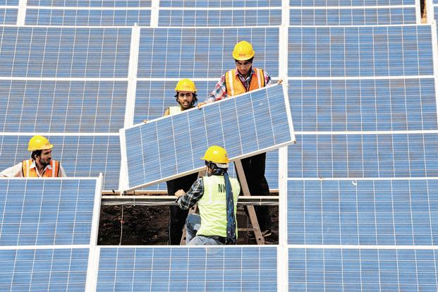 India had a total of 9 GW of solar capacity, including rooftop projects, as of December. Photo: AFP (AFP)