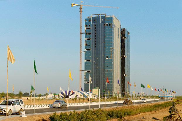 he government's move is likely to benefit private companies setting up shop in Gujarat International Finance Tec-City, or GIFT City, inaugurated in April 2015 as India's first IFSC. Photo: AFP (AFP)