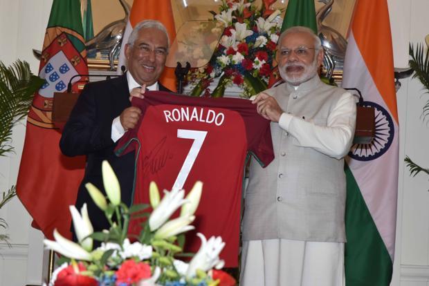 a46705c6c4a ... Prime Minister Narendra Modi and his Portuguese counterpart Antonio  Costa pose with the Cristiano Ronaldo jersey