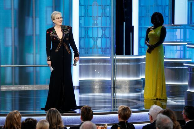 Actress Meryl Streep (L) accepts the Cecil B. DeMille Award from presenter Viola Davis during the 74th Annual Golden Globe Awards show in Beverly Hills, California. Photo: Reuters
