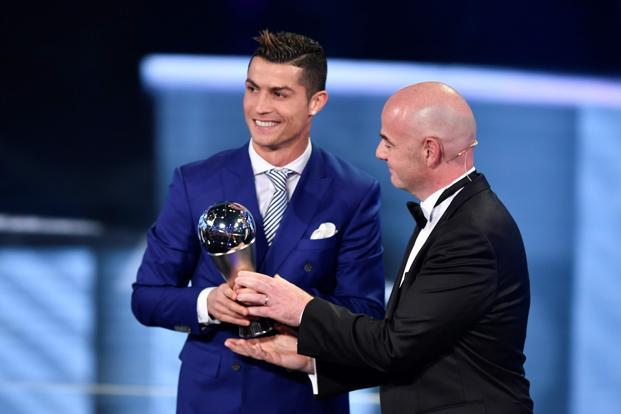 Real Madrid and Portugal's forward Cristiano Ronaldo is presented with The Best FIFA Men's Player of 2016 Award by FIFA president Gianni Infantino. Photo: AFP