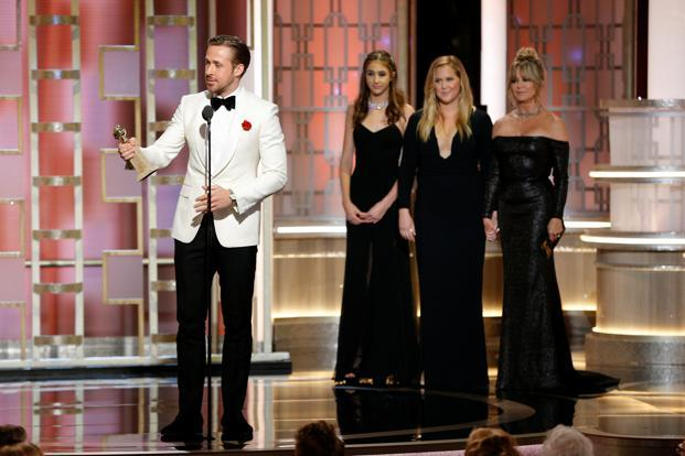 In one of the evening's more emotional acceptance speeches, La La Land's Ryan Gosling dedicated his award to the late brother of his partner, Eva Mendes. Photo: Reuters