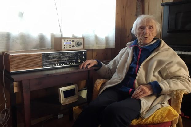 Judith Haaland sits next to her decades-old radio set in Stavanger, Norway. By the end of the year, national networks will be available only on Digital Audio Broadcast. Photo: AP