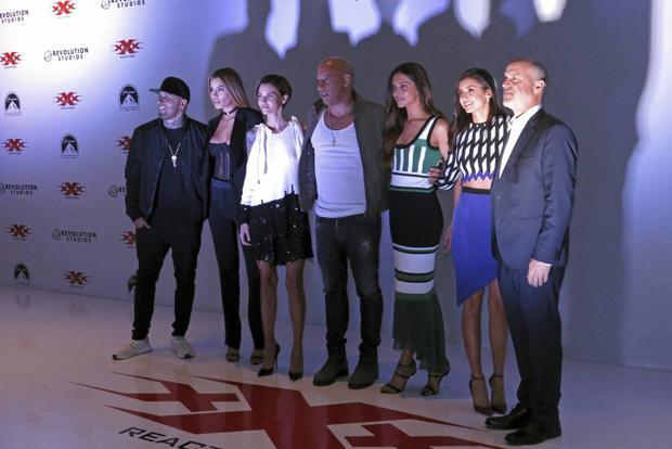(From left) Actors from the film 'xXx: Return of Xander Cage', Nicky Jam, Ariadna Gutierrez, Ruby Rose, Vin Diesel, Deepika Padukone and Nina Dobrev pose for a portrait with director D.J. Caruso in Mexico City on 5 January. Photo: AP