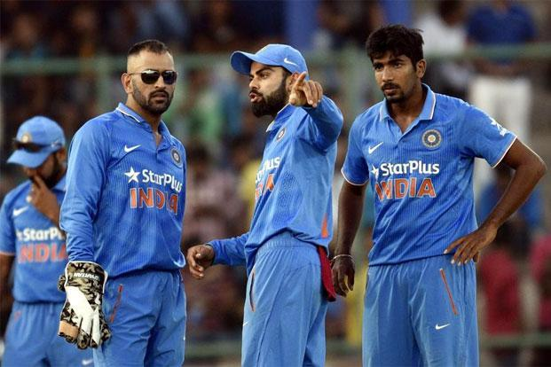 Mahendra Singh Dhoni's (left) exit as captain leaves Virat Kohli (centre) in charge of the Indian team across formats. Photo: Mohd Zakir/Hindustan Times