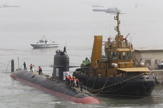 A file photo of Indian Navy's Scorpene submarine INS Kalvari being escorted by tugboats as it arrives at Mazagon Docks Ltd, in Mumbai. Photo: Reuters
