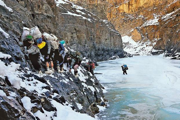 Zanskaris avoid a section of thawed ice by threading their way over a precipice in the gorge.