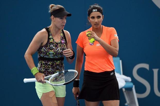 Sania Mirza (R) and Bethanie Mattek-Sands at the Brisbane International tennis tournament semi-final. Photo: AFP