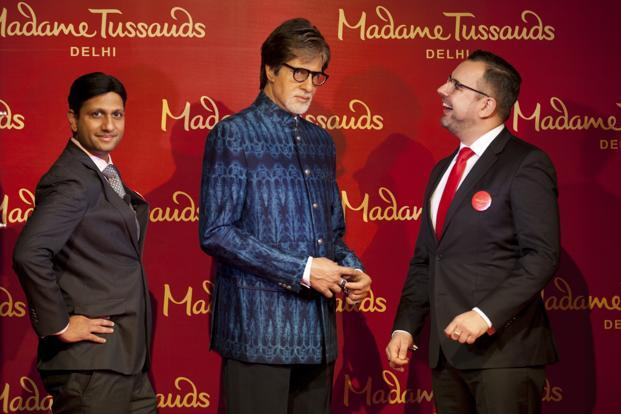 Merlin Entertainments's India general manager and director, Anshul Jain (left) and director, New Openings Europe and emerging markets, Marcel Kloos (right) pose with a wax statue of Bollywood superstar Amitabh Bachchan on 12 January 2017. Photo: AP