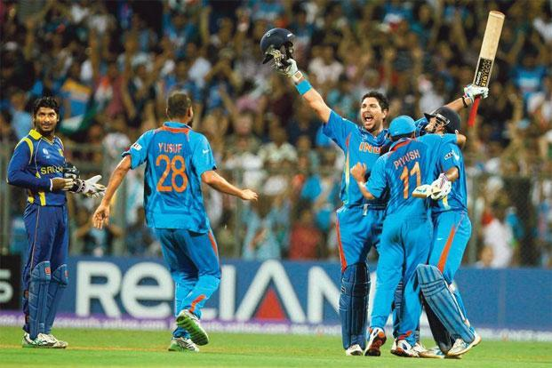 Yuvraj Singh celebrates India's 2011 World Cup title with teammates. Photo: Manoj Patil/Hindustan Times.