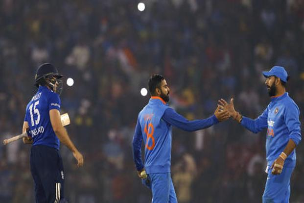 India's captain Virat Kohli and Yuvraj Singh celebrate their victory in the second one-day international cricket match at the Barabati Stadium in Cuttack. Photo: AP