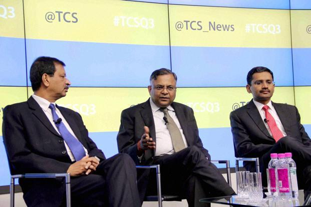 Gopinathan (extreme right) needs to address three challenges—retaining talent, winning contract rebids, and execution. Photo: PTI