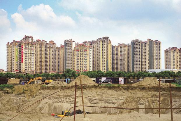 Property analysts said maximum delays have been faced by premium projects, where sales have slowed and cash flows have been tepid, leading to developers delaying completion. Photo: Ramesh Pathania/Mint