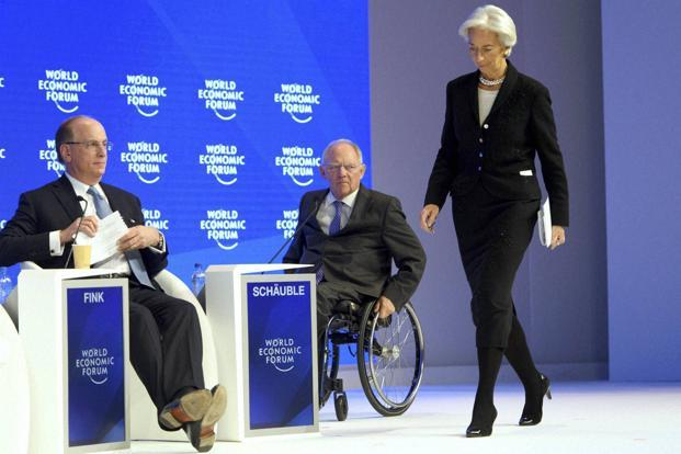 Christine Lagarde, managing director of International Monetary Fund (IMF), arrives on stage at the World Economic Forum, WEF, in Davos, Switzerland, on 20 January. Photo: AP