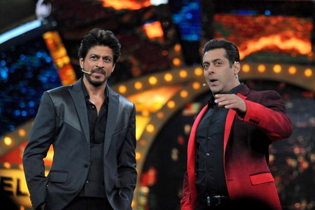 Actors Shah Rukh Khan (left) and Salman Khan pose during the promotion of upcoming Hindi film 'Raees' on the set of reality show 'Bigg Boss 10' in Lonavla on Friday. Photo: AFP