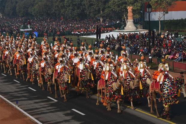 A Border Security Force contingent on camels marches during the full-dress rehearsal for the upcoming Republic Day parade in New Delhi on Monday. AFP
