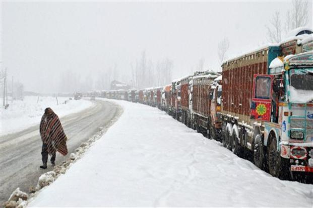 A file photo of stranded goods trucks on snow covered Srinagar-Jammu national highway during the second day of heavy snowfall. Photo: PTI