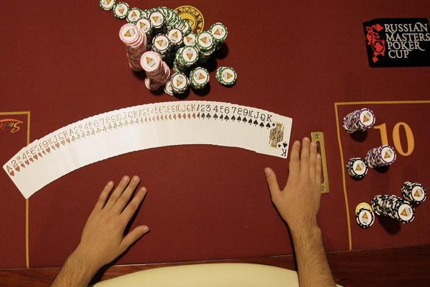 The number of chips each player holds is reset after every hand, eliminating the complicated psychological game through which players with more chips intimidate poorer players by forcing them to make big bets. Photo: Reuters