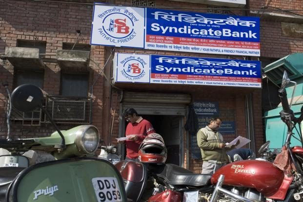 Syndicate Bank shares closed down at Rs66.95 on the BSE, down 3.39% from its previous close, while India's benchmark Sensex index lost 0.70% to 27,655.96 points. Photo: Mint