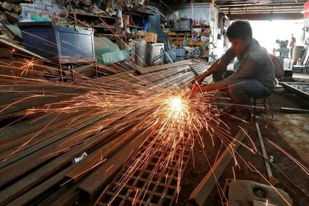 In China, the world's second-biggest economy, factory activity expanded for the sixth month in December, according to an official PMI survey, led by an investment and construction boom that has helped spur global growth. Photo: Reuters