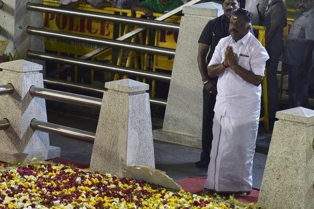 O. Panneerselvam in front of late Jayalalithaa's burial site at the Marina Beach in Chennai on Tuesday. Photo: PTI