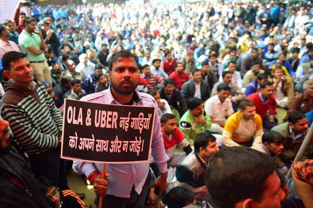Ola and Uber taxi drivers on strike against withdrawal of driver incentives, at Jantar Mantar in New Delhi on Friday. Pradeep Gaur/Mint