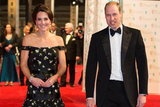 Britain's Prince William and his wife Kate, the Duchess of Cambridge arrive for the Bafta awards at the Royal Albert Hall in London, on Sunday. Britain, Photo: Daniel Leal-Olivas/Reuters