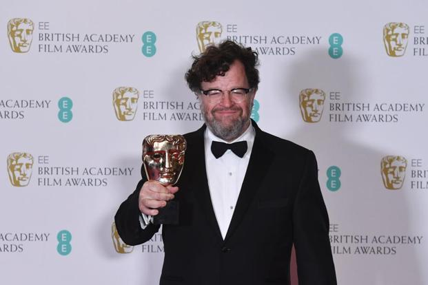 Kenneth Lonergan poses with his original screenplay award for 'Manchester By The Sea'.