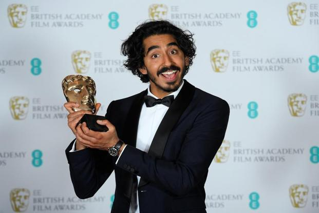 Dev Patel poses with his best supporting actor for his role in 'Lion'. The biopic charts the real-life story of an Indian boy adopted by an Australian couple. The film also won an award for best adapted screenplay