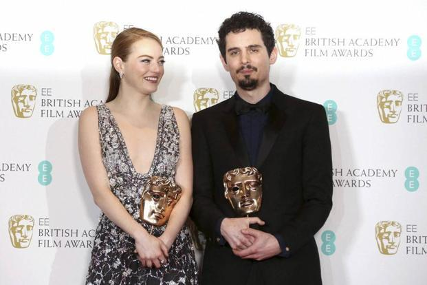 Actress Emma Stone with her BAFTA award for Best Actress and director Damien Chazelle with his BAFTA award for Best Director both for the film 'La La Land'. Photo: AP