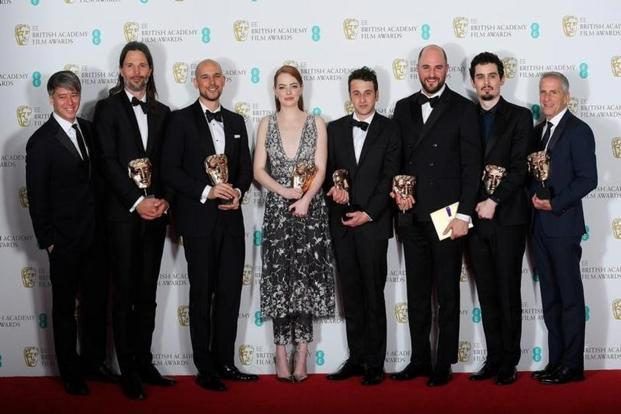 The team behind 'La La Land' hold their awards for Best Film at the British Academy of Film and Television Awards at the Royal Albert Hall in London. Photo: Reuters