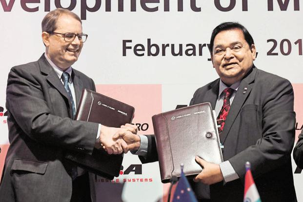 Larsen and Toubro group executive chairman A. M. Naik (right) and MBDA chief executive officer Antoine Bouvier after signing the joint venture agreement. Photo: AFP