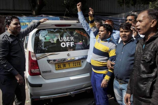 Uber has 2,00,000 active drivers and Ola has 4,50,000 vehicles in India. Photo: PTI