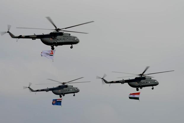 The air display began with Mi-17 helicopters trooping in the Indian tricolour, Indian Air Force and Aero India flags on Tuesday.