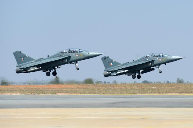 A pair of Tejas Light Combat Aircraft take off during a display on the Aero India exhibition at Yelahanka Air Force Station in Bengaluru on Wednesday. Photo: AFP