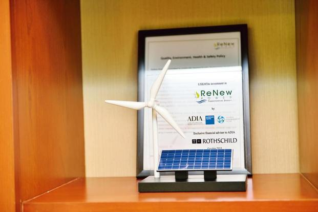 A model of a wind turbine and a solar panel. Photographs by Priyanka Parashar/Mint