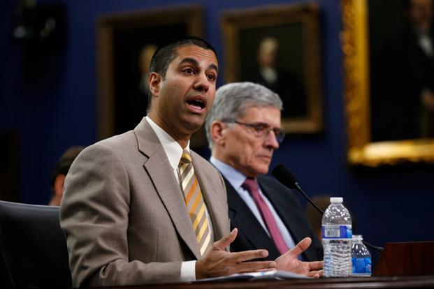 Ajit Pai (left) Photo: Reuters