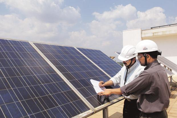 Solar may pass coal and account for all new capacity on the grid in the next decade, according to a 13 February report issued by India's Energy and Resource Institute. Photo: Hemant Mishra/Mint