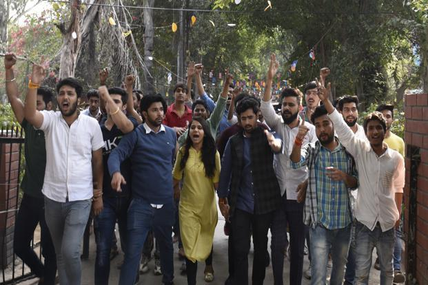 ABVP activists protesting on Tuesday against an invitation to JNU students Umar Khalid, Shehla Rashid to attend a seminar at Ramjas College. Photo: Hindustan Times