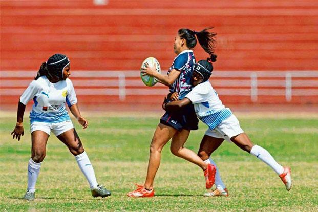 Indian players (in white) at the Asia Rugby Women's Sevens Trophy event in Laos. Photo: Rugby India.