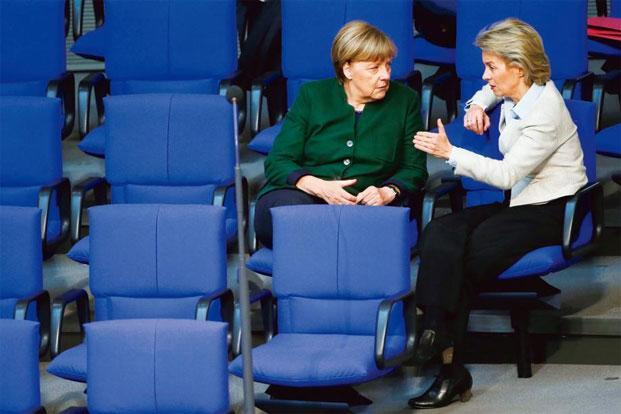 A file photo of German chancellor Angela Merkel (left) with defence minister Ursula von der Leyen. Photo: Fabrizio Bensch/Reuters