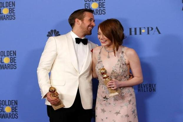 Ryan Gosling and Emma Stone pose with their awards during the 74th Annual Golden Globe Awards in Beverly Hills. Photo: Reuters