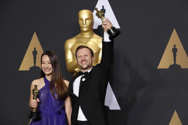 Orlando von Einsiedel (right) and Joanna Natasegara hold their Oscars for Best Documentary Short Subject for 'The White Helmets'.