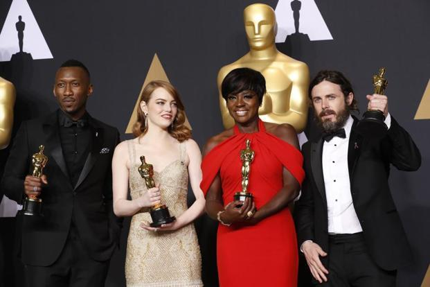 Best Supporting Actor Mahershala Ali, for 'Moonlight', Best Actress Emma Stone for 'La La Land', Best Supporting Actress Viola Davis, for 'Fences' and Best Actor Casey Affleck for 'Manchester by the Sea' (left-right), hold their Oscars.