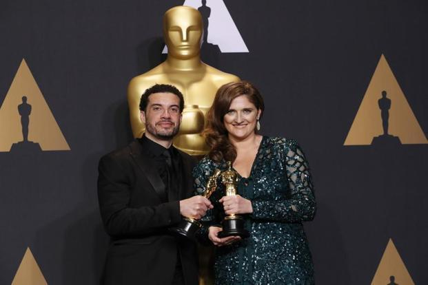 Ezra Edelman and Caroline Waterlow with their Best Feature Documentary award for 'O.J.: Made in America'.