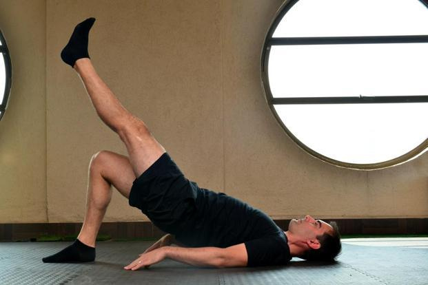 Single leg hip bridge. Photographs by Aniruddha Chowdhury/Mint