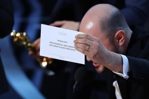 'La La Land' Producer Jordon Horowitz holds up the card for the Best Picture winner 'Moonlight'. Photo: Reuters