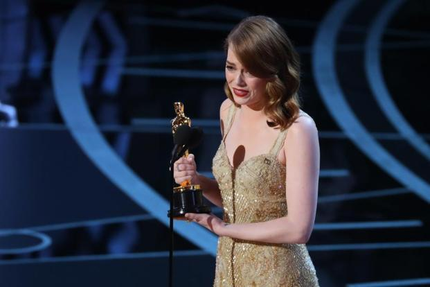 Best Actress winner Emma Stone accepts her award for 'La La Land'. Photo: Reuters