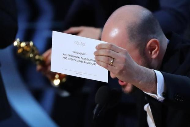 'La La Land' producer Jordon Horowitz holds up the card for the Best Picture winner 'Moonlight' following the mix-up. Photo: Reuters